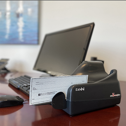 photo of a panini remote deposit check scanner on a desk